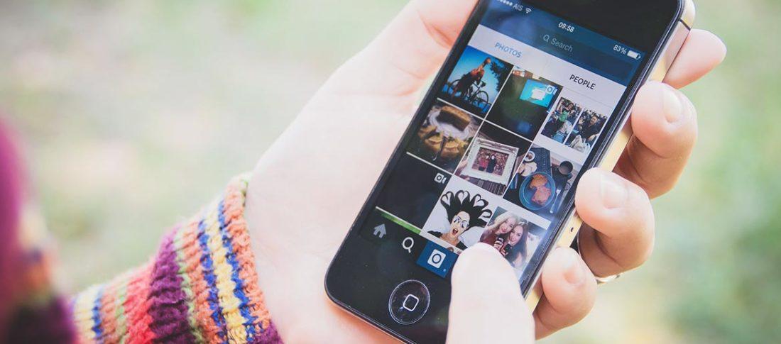 Girl using Instagram on mobile phone
